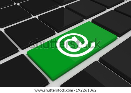 At symbol against black keyboard with green key