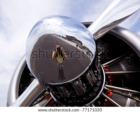 AT-6 Texan, known as the Harvard training plane engine with reflection of photographer in propeller - stock photo