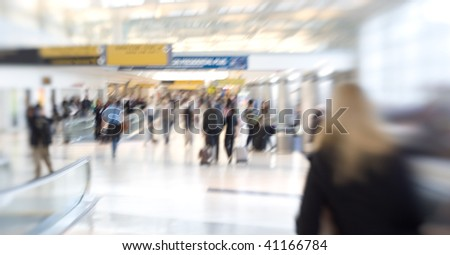 At the airport - blurred business people - stock photo