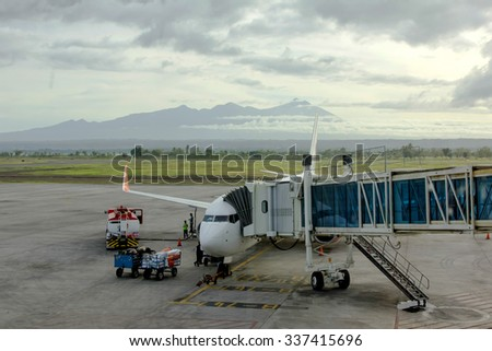 At the airport on loading in airplane - stock photo