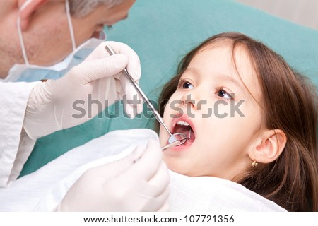 at the dentist - little girl have a consultation - stock photo