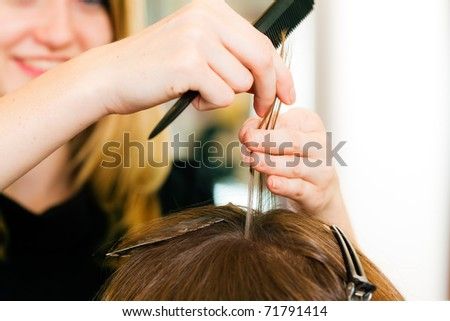 At the hairdresser � woman gets new hair colour; close-up on hands - stock photo