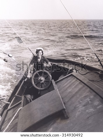 At the helm - stock photo