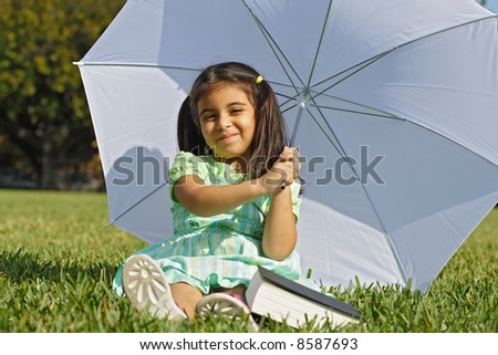 At the park with an Umbrella - stock photo