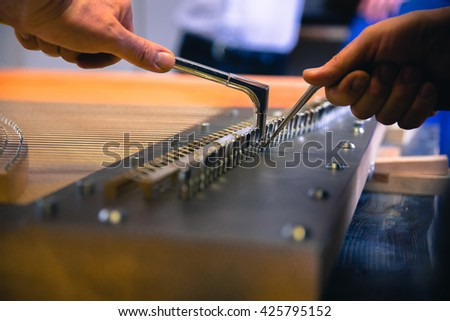 at the piano workshop - stock photo
