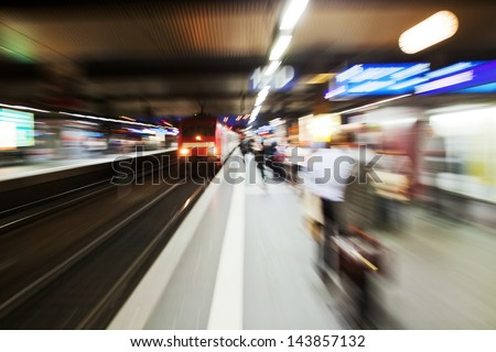 at the railway station in motion blur - stock photo
