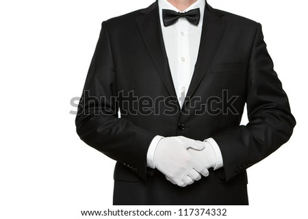 At Your service, well dressed man waiting for orders isolated on white background with copy space - stock photo