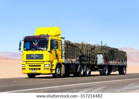 ATACAMA, CHILE - NOVEMBER 14, 2015: Modern truck MAN TGA at the interurban freeway through the Atacama desert. - stock photo