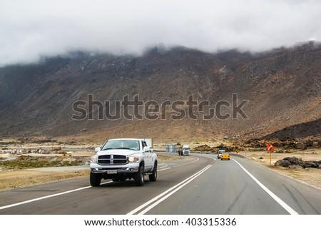 ATACAMA, CHILE - NOVEMBER 14, 2015: White pickup truck Dodge Ram at the interurban freeway, - stock photo