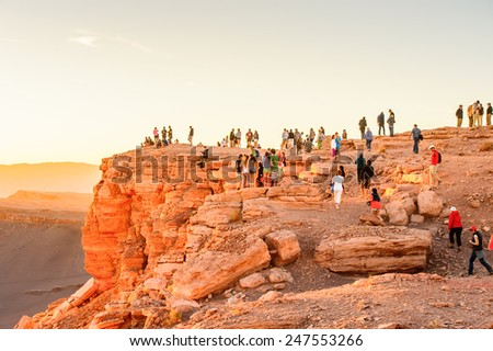 ATACAMA DESERT, CHILE - NOV 3, 2014: Unidentified tourists in the Atacama desert, Chile. Atacama Desert proper occupies 105,000 square kilometres