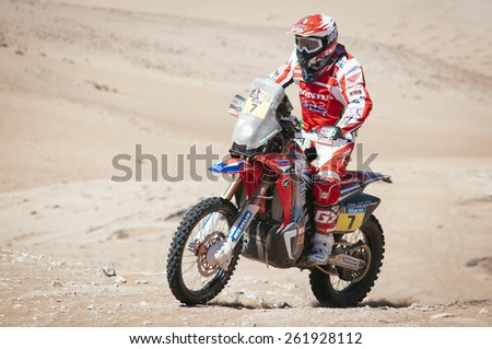Atacama Desert, Copiapa, CHILE. January 07, 2015. Portuguese moto pilot PAULO GONCALVES race on the sand dunes of the Atacama Desert in Chile during the Chilean stage of Dakar Rally 2015. - stock photo
