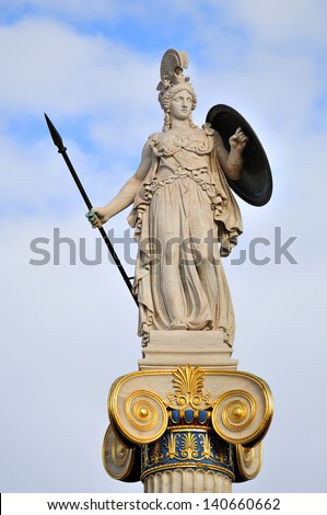 Athena, Ancient Greeks' goddess of heroic endeavor and wisdom. The statue is located by the main entrance of the Academy of Athens, Greece. - stock photo