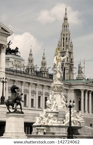 Athena Fountain and the Austrian Parliament in front, Vienna City Hall in the rear of the picture (sepia image). - stock photo