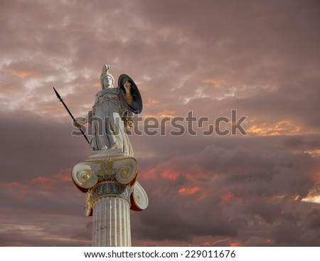 Athena statue, the goddess of wisdom and philosophy under a fiery sky - stock photo