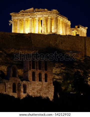 Athens Acropolis Parthenon and Roman odeon arches  night view - stock photo