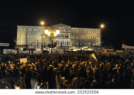 Athens, Feb 15, 2015. People gather in front of the parliament during an anti-austerity and pro-government demonstration to support the newly elected government's for a better deal on Greece??s debt - stock photo