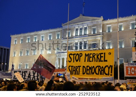 Athens, Feb 15, 2015. People gather in front of the parliament during an anti-austerity and pro-government demonstration to support the newly elected government??s for a better deal on Greece??s debt - stock photo