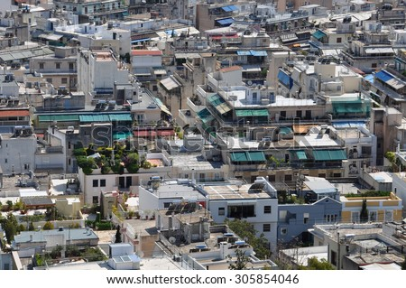 ATHENS, GREECE - APRIL 20, 2014: Apartment building rooftops aerial view of downtown Athens, Greece. - stock photo