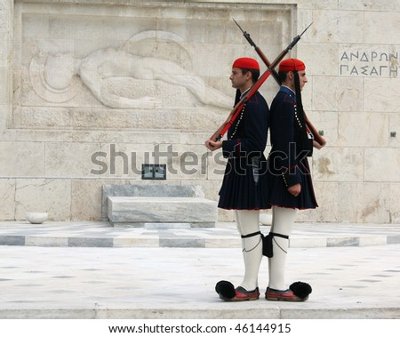 ATHENS, GREECE - APRIL 21: Evzones (presidential ceremonial guards) guarding the Tomb of the Unknown Soldier at the Hellenic Parliament Building, April 21, 2009 in Athens, Greece. - stock photo