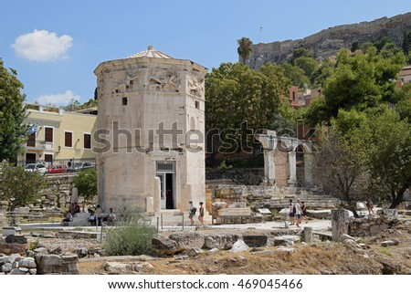 ATHENS, GREECE - AUGUST 4, 2016: People visiting tower of the winds. Ancient agora of Athens, Greece.