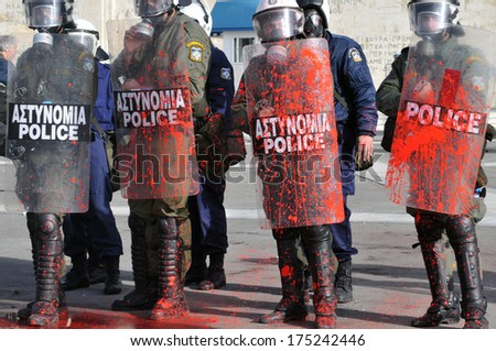 ATHENS, GREECE-FEB. 23 Protesters with their faces covered , during demonstration in Syntagma square in Athens  February 23, 2011.     - stock photo