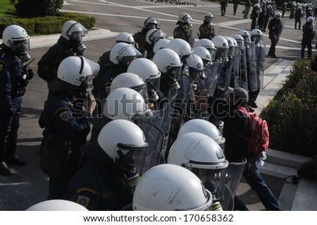 ATHENS, GREECE-FEB.23. Pushing against riot police shields. During demonstration in Athens, February 23, 2011. - stock photo