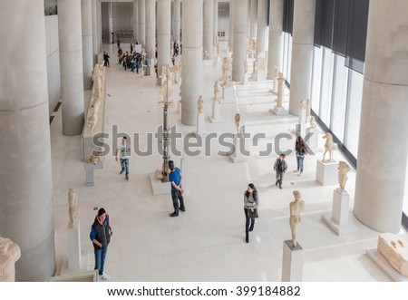 ATHENS, GREECE - FEB 8, 2016: Spectacular Interior View of the New Acropolis Museum in Athens with visitors. Designed by the Swiss-French Architect Bernard Tschumi. Open to the public since 2009. - stock photo