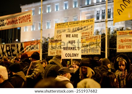 Athens Greece February 11, 2015 Protesters with signs during an anti-austerity, pro-government demonstration outside the Greek parliament on the eve of a crucial euro zone finance ministers meeting.  - stock photo