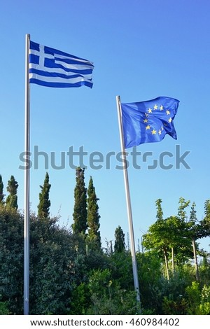 ATHENS, GREECE -10 JULY 2016- A Greek and European Union (EU) flags flying side by side.