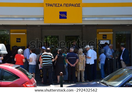 ATHENS, GREECE - JULY 1, 2015: Crowd of people queue at Piraeus bank one of the few branches open to the public only for pensioners without ATM cards to withdraw part of their pension in cash money. - stock photo