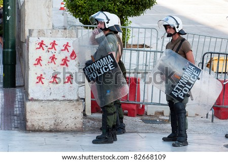 ATHENS, GREECE - JULY 8: Greek riot police stand poised during demonstration near Parliament building In Syntagma Square, July 8, 2011. - stock photo