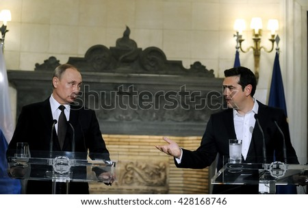 Athens, Greece - May 27, 2016: Greek Prime Minister Alexis Tsipras (R) and President of the Russian Federation Vladimir Putin give a joint press conference after their meeting - stock photo