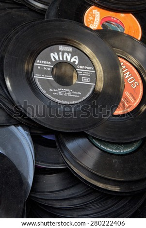 "ATHENS, GREECE - MAY 21, 2015: Old records pile of dusty 45s scratched 7"" vinyl singles background. Selective focus. - stock photo"
