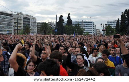 ATHENS, GREECE - MAY 26. Thousands  of young  protesters against unpopular taxes and austerity measures in front of the Greek Parliament building in Athens, May 26, 2011.