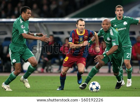 ATHENS, GREECE - NOV 24 : Gilberto of Panathinaikos (L) in action with Iniesta of Barcelona (R) during the UEFA Champions League match Panathinaikos vs Barcelona on November 24, 2010 in Athens, Greece - stock photo