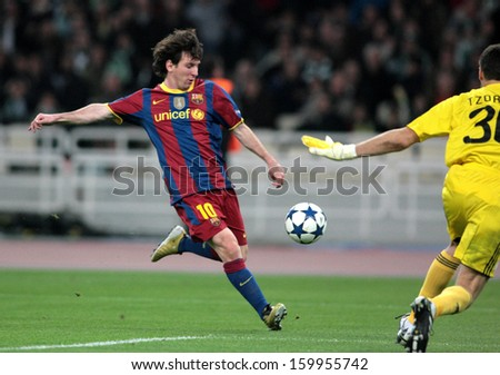 ATHENS, GREECE - NOV 24 : Messi of Barcelona shooting the ball during the UEFA Champions League group stage match Panathinaikos vs Barcelona on November 24, 2010 in Athens, Greece - stock photo