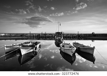 Athens, Greece - October 01 2015: Fishing boats in a small harbour in Palaio Faliro in Athens, Greece