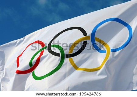ATHENS, GREECE- OCTOBER 2, 2013: White Olympics Flag against the blue sky in Athens, Greece. - stock photo