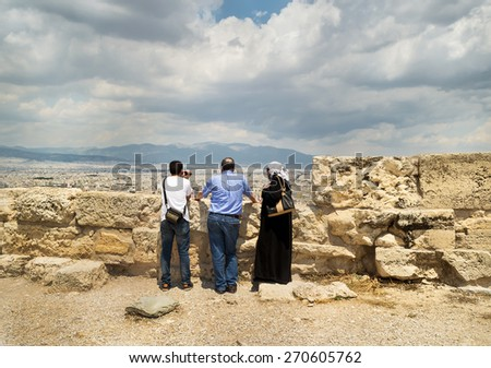 ATHENS, GREECE 22.06.2014 Unidentified visitors  the Temple of Athena  at Acropolis . View of the City.