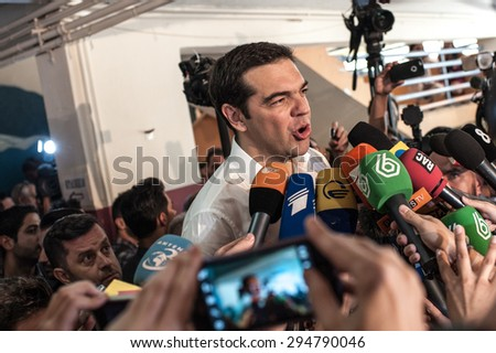 ATHENS, JUNE 5, 2015: Prime Minister Alexis Tsipras in the polling station after voting for the Greek referendum, speaks to reporters in Kerkyras Kastalia street in Athens. - stock photo