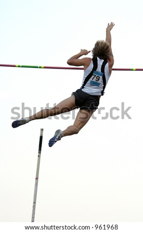 Athlete clearing the bar during a pole vault event