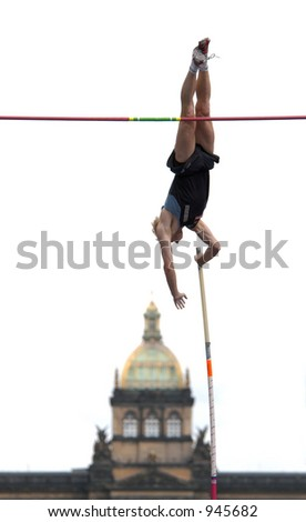 Athlete clearing the bar during a pole vault event in Prague, Czech Republic (image contains some noise) - stock photo