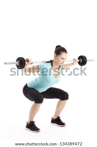 Athlete does squats with barbell - stock photo