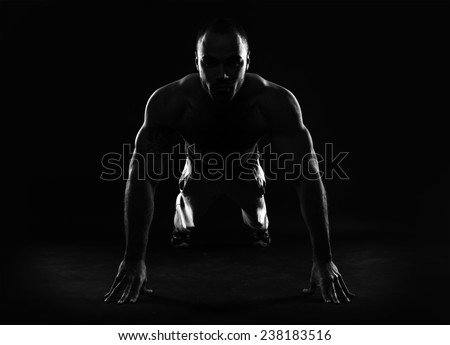 Athlete doing squeezing.  - stock photo