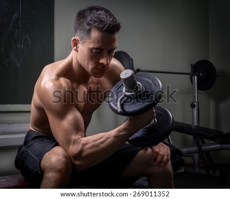Athlete in the gym - stock photo