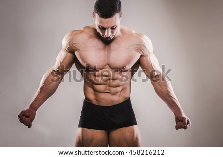athlete in the studio with a lowered gaze. - stock photo