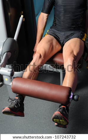 Athlete leg muscles. Quadriceps working out. Caucasian muscular sportsman. - stock photo