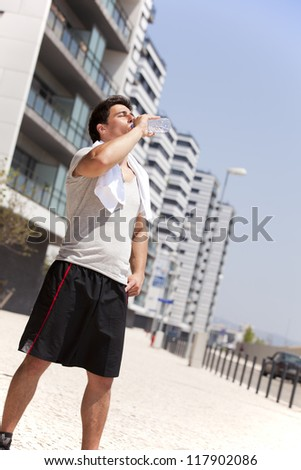 Athlete man tired after a long running sport event in the city - stock photo