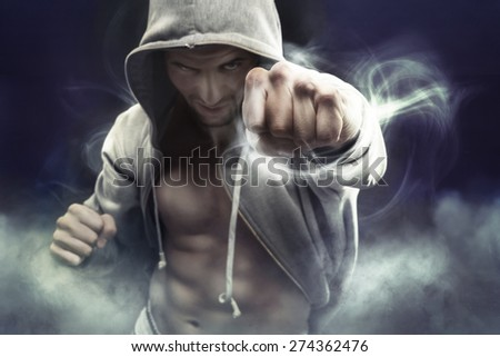 Athlete man with a lot of internal force - stock photo