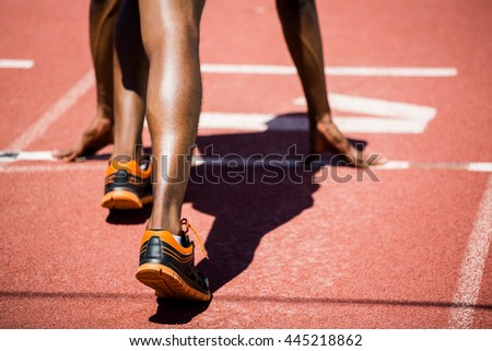 Athlete on a starting line about to run on running track